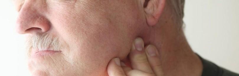 Боль в челюсти возле уха слева и справа: причины