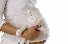 С чем связана мутная моча при беременности?